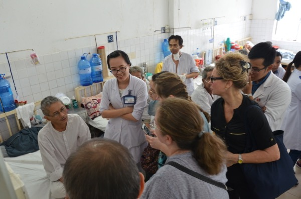 On rounds with the Oncologist at the Men's ward in the Oncology Hospital, Ho Chi Minh City, Vietnam
